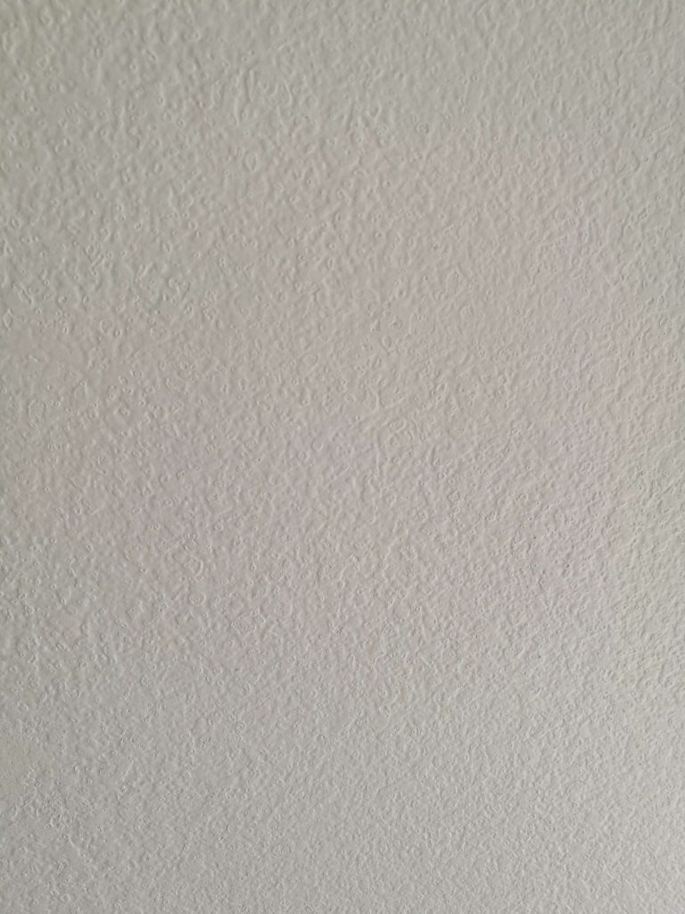 Bedroom reveal wall detail after sanding