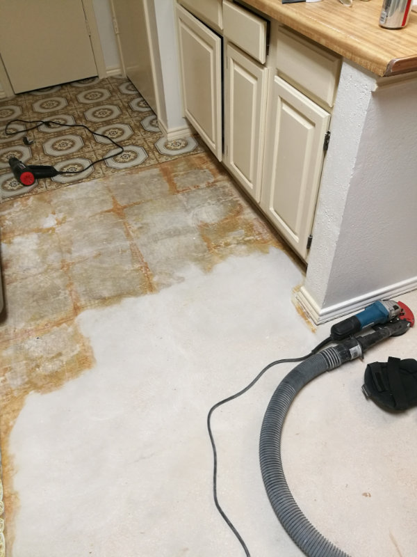 Grinding old floor glue from concrete